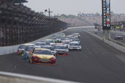 Joey Logano leads into first turn following caution.