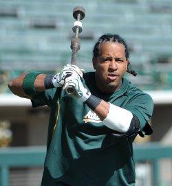 Manny Ramirez of the Oakland Athletics warms up in Phoenix, Arizona