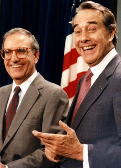 Robert Dole and George Mitchell at a news conference.