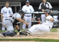 White Sox's Konerko Scores against Tigers in Chicago