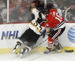 Blackhawks' Ladd boards Bruins Boychuk in Chicago