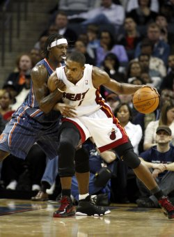 Chris Bosh in action as the Miami Heat play the Charlotte Bobcats