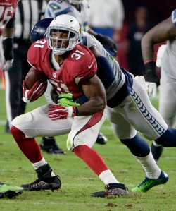Cardinals' Johnson is tackled from behind