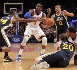 New York Knicks Amar'e Stoudemire, Utah Jazz Paul Millsap (24), Earl Watson (11) and Gordon Hayward at Madison Square Garden in New York