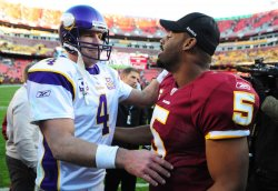Minnesota Vikings quarterback Bret Favre greets Redskins quarterback Donovan McNabb in Washington