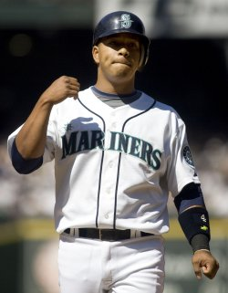 Seattle Mariners' Jose Lopez pumps his fists after hitting a single to left field against the New York Yankees in the fifth inning at SAFECO Field.