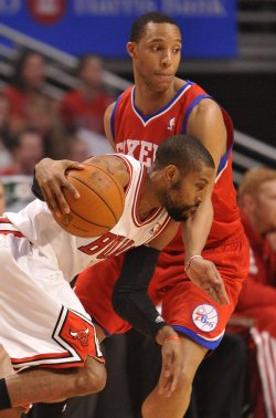 Bulls' Watson drives on 76ers Turner during Playoff in Chicago