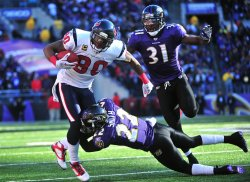 Texans' Andre Johnson runs for a 13-yard gain in Baltimore