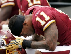 Washington Redskins wide receiver Devin Thomas hangs his head during loss to Carolina Panthers