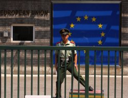 A Chinese soldier stands guard in front of the EU's embassy in Beijing