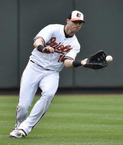 Orioles left fielder Nolan Reimold fields a single by White Sox Melky Cabrera