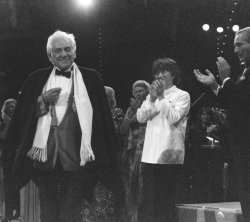 Conductor-composer Leonard Bernstein applauded by Boston Symphony Orchestra conductor Seiji Ozawa