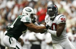 Houston Texans Fefensive End Mario Williams Tries to Get Around New York Jets Tight End Dustin Keller at Reliant Stadium in Houston