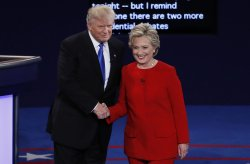 Democrat Hillary Clinton greets Republican Donald Trump during the first Presidential Debate at Hofstra University in New York