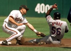 New York Mets Brian McRae is caught trying to steal second