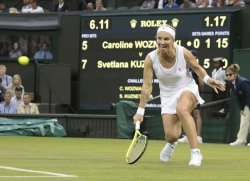 Russian Svetlana Kuznetsova returns the ball