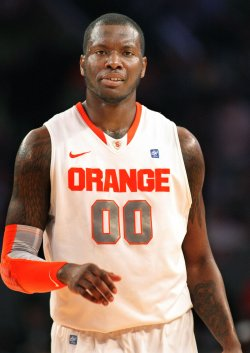 Rick Jackson of Syracuse takes on St. John at NCAA Big East Basketball Championship in New York