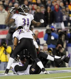 Baltimore Ravens Carey Williams and Bernard Pollard react when Jimmy Smith makes an interception in the AFC Championship Game at Gillette Stadium in Massachusetts
