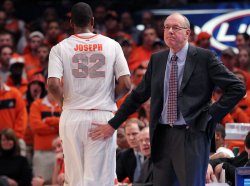 Syracuse Orange head coach Jim Boeheim taps Kris Joseph at the NCAA Big East Men's Basketball Championships in New York
