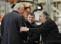 Chrysler Chairman and CEO Marchionne pats Illinois Gov. Quinn on the back in Belvidere, Illinois