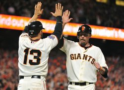 Giants' Aubrey Huff celebrates with teammate Cody Ross during game 2 of the World Series in San Francisco