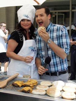 "Valerie Bertinelli and Ross Mathews serve and cook food at the Jenny Craig ""Jenny's Party in the Plaza"" in New York"