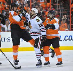 Flyers' Chris Pronger and Danny Briere push Blackhawks Andrew Ladd during the 2010 Stanley Cup Final