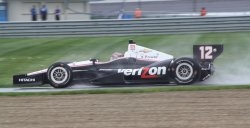 Drivers qualify in the rain for the inaugural Grand Prix of Indianapolis at the Indianapolis Motor Speedway