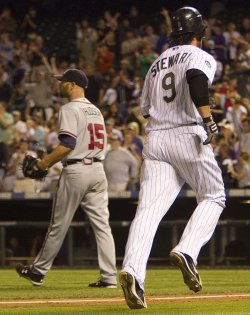 Rockies Stewart Trots Past Braves Pitcher Hudson After Home Run in Denver