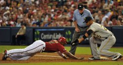 Diamondbacks' Upton slides into first base in the first inning in Arizona