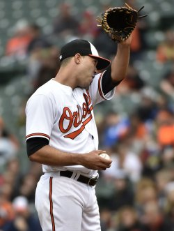 Orioles pitcher Ubaldo Jimenez wipes his face after giving up five runs to the Wihite Sox