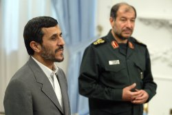 Iran's President Mahmoud Ahmadinejad meets Syrian Defense Minister Hassan Turkmany in Tehran