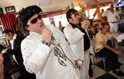 Israeli Elvis impersonators perform on the anniversary of Elvis' death at the Elvis Inn outside Jerusalem