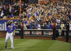 New York Mets shortstop Ruben Tejada tips his hat