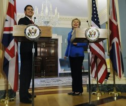 Sec. Clinton and British Foreign Secretary Miliband depart a press conference in Washington