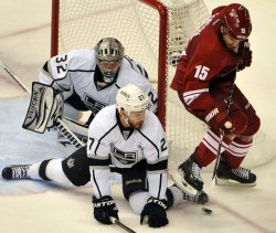 Coyotes Gordon and Kings Martinez and Quick look for puck in Arizona