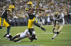 Packers Jennings breaks tackle by Roman Harper in Green Bay, Wisconsin
