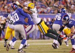 Green Bay Packers Charles Woodson gets called for an Illegal Contact penalty on New York Giants Eli Manning at MetLife Stadium in New Jersey