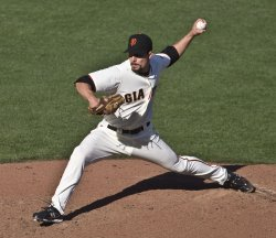 Giants Javier Lopez pitches in relief against the Phillies in game three of the NLCS in San Francisco