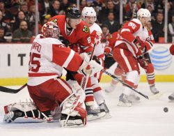 Blackhawks Kopecky collides with Red Wings Howard in Chicago
