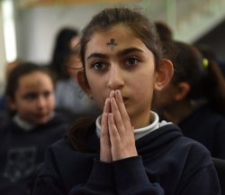 A Palestinian Prays On Ash Wednesday In West Bank
