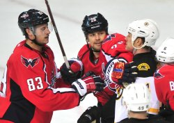 Capitals Jay Beagle and Matt Hendricks fight Boston Bruins' Joe Corvo in Washington