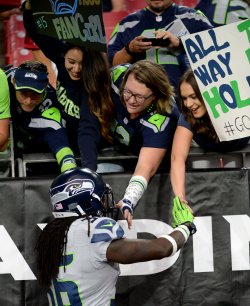 Seahawks' Collins shakes hands with fans