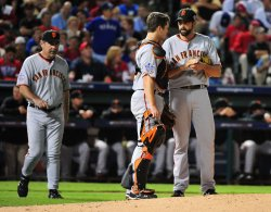 Giants' catcher Buster Posey talks to pitcher Jeremy Affeldt in game 3 of the World Series in Texas