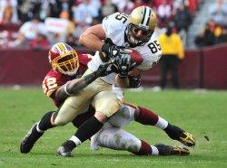 Saints' David Thomas catches a pass over Washington Redskins Rockey McIntosh in Landover, Maryland