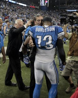 Detroit Lions Head Coach Jim Schwartz hugs Nate Burleson in Detroit