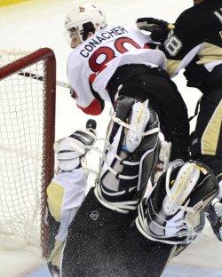 Senators Conarcher Flies Over Penguins Vokoun in Pittsburgh