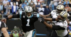 Carolina Panthers quarterback Cam Newton sacked by New Orleans Saints