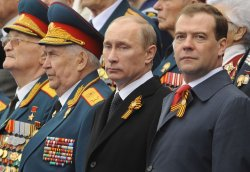 Russian President Putin and PM Medvedev attend the Victory Day parade