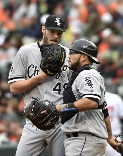 White Sox pitcher Chris Sale talks to catcher Dioner Navarro after back-to-back walks against Baltimore